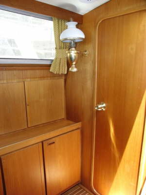 cupbords and door to aft cabin from the saloon